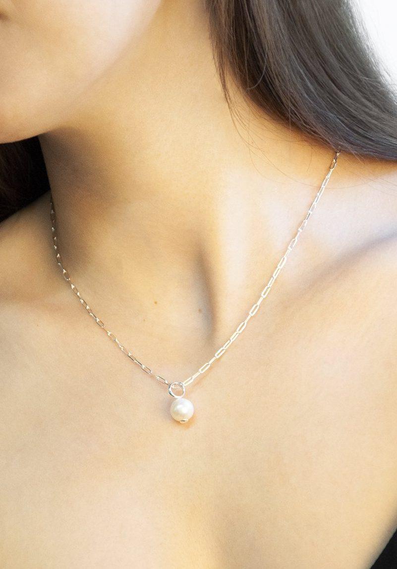 woman wearing featured jewellery - earrings, necklace and bracelet